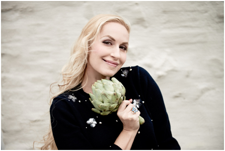 Elna-Margret shows off one of her healthy garden ingredients – artichokes are a food that makes you glow