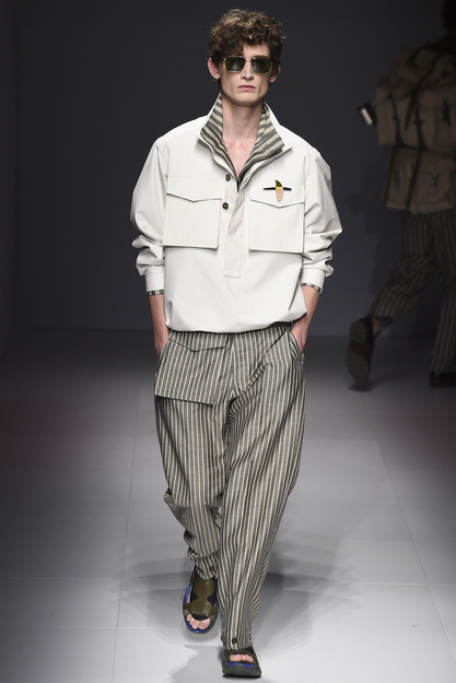 Pants in striped linens and safari jackets with mini brooches, seen at the Salvatore Ferragamo SS17 show
