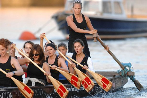 Emma, standing, rowing with Kate Middleton, seated at back.